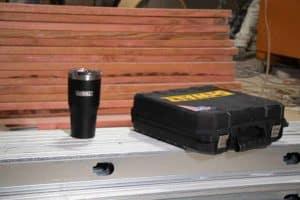 DEWALT 30 oz Black Powder Coated Industrial Drinkware And Tools Lifestyle At Job Site